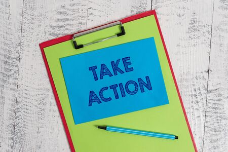 Text sign showing Take Action. Business photo showcasing to do somethingoract in order to get a particular result Colored clipboard blank paper sheet marker sticky note wooden background