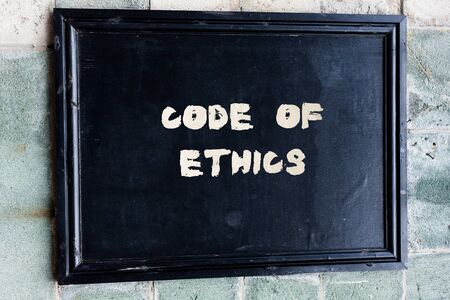 Writing note showing Code Of Ethics. Business concept for basic guide for professional conduct and imposes duties