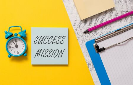 Word writing text Success Mission. Business photo showcasing getting job done in perfect way with no mistakes Task made Notepads clipboard colored paper sheet marker alarm clock wooden background