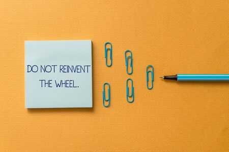 Word writing text Do Not Reinvent The Wheel. Business photo showcasing stop duplicating a basic method previously done Colored blank sticky note clips binders gathered pen trendy cool background
