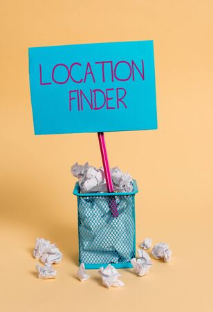 Word writing text Location Finder. Business photo showcasing A service featured to find the address of a selected place crumpled paper trash and stationary with note paper placed in the trash can Stock Photo