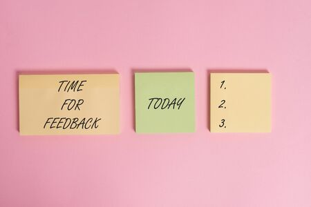 Writing note showing Time For Feedback. Business concept for information about reactions to a product or services Close up front view three multicolor blank notepads colored background