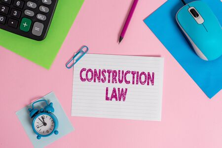 Word writing text Construction Law. Business photo showcasing deals with matters relating to building and related fields Mouse calculator sheets clip marker note alarm clock colored background