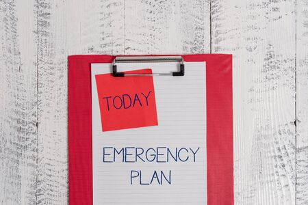 Conceptual hand writing showing Emergency Plan. Concept meaning Procedures for response to major emergencies Be prepared Colored clipboard blank paper sheet sticky note wooden background