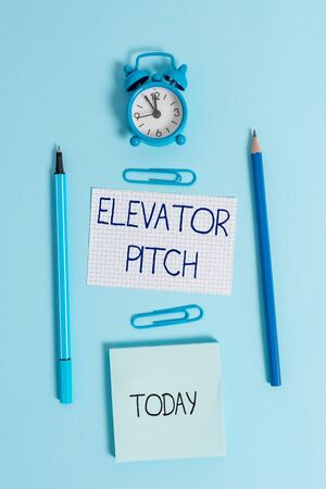 Writing note showing Elevator Pitch. Business concept for A persuasive sales pitch Brief speech about the product Alarm clock squared paper sheet notepad markers colored background