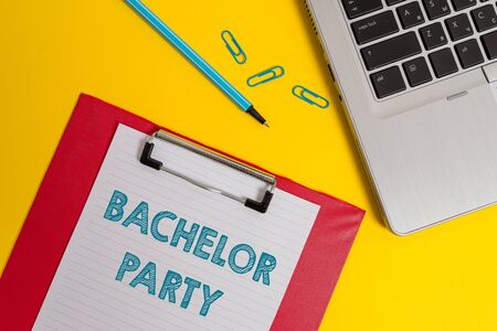 Word writing text Bachelor Party. Business photo showcasing Party given for a analysis who is about to get married Stag night Open laptop clipboard blank paper sheet marker clips colored background
