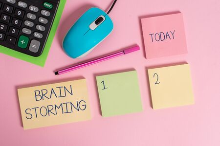 Word writing text Brain Storming. Business photo showcasing Stimulating creative thinking Developing new ideas Discussion Blank notepads wire mouse calculator sheet marker pen colored background