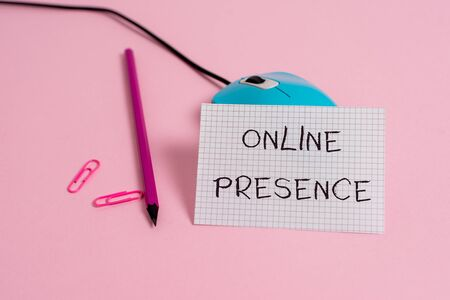 Word writing text Online Presence. Business photo showcasing existence of someone that can be found via an online search Wire vintage mouse clips marker squared paper sheet colored background