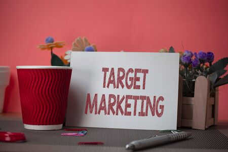 Writing note showing Target Marketing. Business concept for Audience goal Chosen clients customers Advertising Flowers and writing equipments sheet above textured backdrop