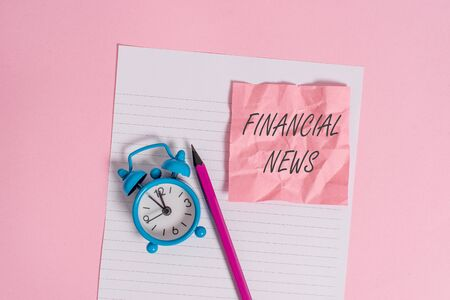 Writing note showing Financial News. Business concept for Investment banking Fund analysisagement Regulation and trading Striped paper sheet note pencil vintage alarm clock colored background