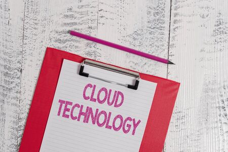 Handwriting text Cloud Technology. Conceptual photo storing and accessing data and programs over Internet Colored clipboard blank paper sheet pencil old wooden vintage background