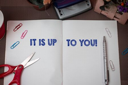 Writing note showing It Is Up To You. Business concept for Used to tell a demonstrating that they are the one to decide Scissors and writing equipments plus math book above textured backdrop