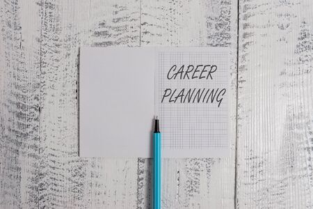 Conceptual hand writing showing Career Planning. Concept meaning Strategically plan your career goals and work success Square notebook fine highlighter lying on wooden background