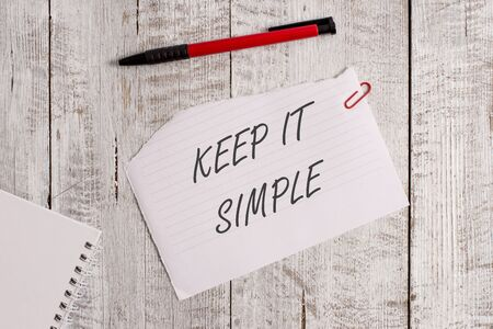 Word writing text Keep It Simple. Business photo showcasing to make something easy to understand and not in fancy way Torn paper and notebook sheet with a pen placed on top of wooden table Stock Photo