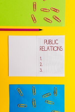 Text sign showing Public Relations. Business photo text practice analysisaging spread of information between individual Blank squared notebook pencil marker paper sheets plain colored background