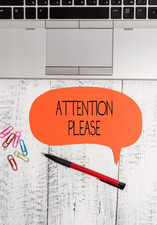 Text sign showing Attention Please. Business photo text Asking showing to focus their mental powers on you Open laptop blank speech bubble pen ballpoint colored clips vintage wooden Stockfoto
