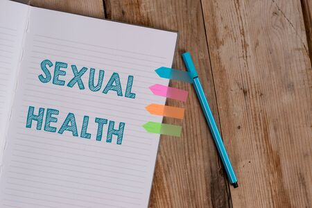 Conceptual hand writing showing Sexual Health. Concept meaning positive and respectful approach to sexual relationships Striped notebook colored arrow banners ballpoint wooden background Stock Photo