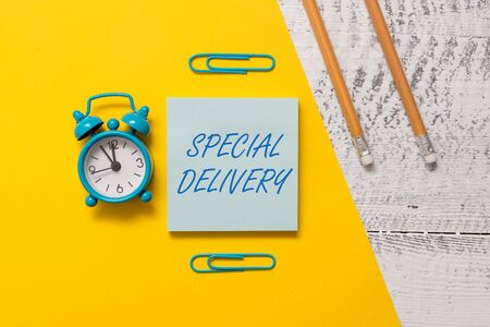 Text sign showing Special Delivery. Business photo text getting products or service directly to your home any place Notepad clips colored paper sheet markers alarm clock wooden background