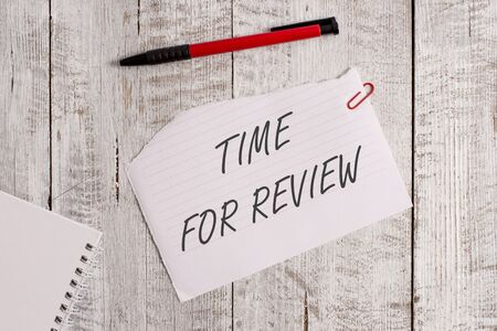Word writing text Time For Review. Business photo showcasing review of a system or situation in its formal examination Torn paper and notebook sheet with a pen placed on top of wooden table Stock Photo