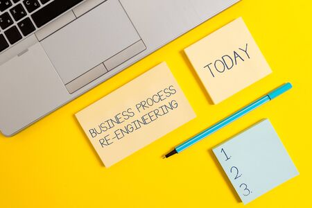 Conceptual hand writing showing Business Process Re Engineering. Concept meaning the analysis and design of workflows Silver laptop square sticky notepads marker colored background