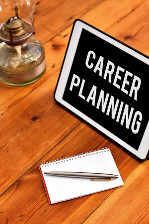 Handwriting text writing Career Planning. Conceptual photo Strategically plan your career goals and work success Writing equipments placed next to gadget plus a classic vintage lantern