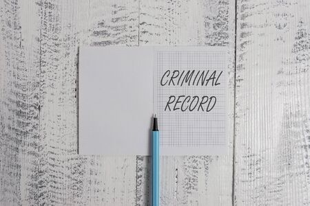 Conceptual hand writing showing Criminal Record. Concept meaning profile of a demonstrating criminal history with details Square notebook fine highlighter lying on wooden background