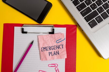 Word writing text Emergency Plan. Business photo showcasing procedures for handling sudden or unexpected situations Laptop clipboard sheet clips pencil note smartphone colored background