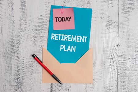Text sign showing Retirement Plan. Business photo text saving money in order to use it when you quit working Envelope blank sheet letter paper sticky note ballpoint wooden background Imagens