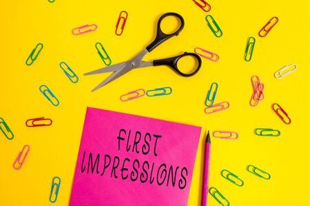 Handwriting text writing First Impressions. Conceptual photo What a demonstrating thinks of you when they first meet you Blank colored paper sheet scissors pencil clips light color background Stock fotó