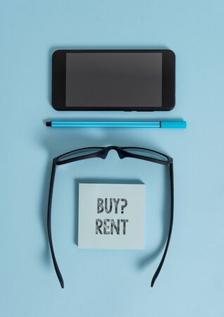 Conceptual hand writing showing Buy Question Rent. Concept meaning Group that gives information about renting houses Dark eyeglasses colored sticky note smartphone pastel background Imagens