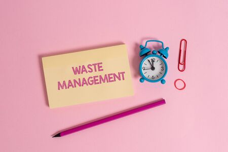 Word writing text Waste Management. Business photo showcasing actions required analysis rubbish inception to final disposal Colorful blank notepad marker retro alarm clock clip colored background