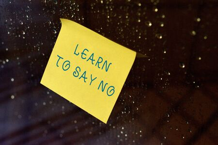 Conceptual hand writing showing Learn To Say No. Concept meaning decline or refuse few things before you destroy yourself Square paper piece notation stick to textured glass window Stock Photo
