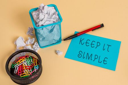 Text sign showing Keep It Simple. Business photo text to make something easy to understand and not in fancy way crumpled paper trash and stationary with note paper placed in the trash can Stock fotó