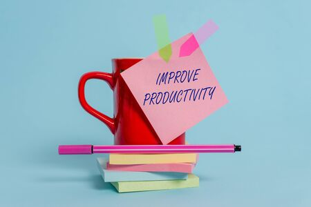 Word writing text Improve Productivity. Business photo showcasing to increase the machine and process efficiency Cup sticky note arrow banners stacked pads pen lying pastel background