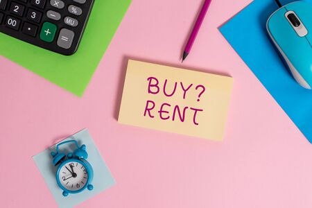 Handwriting text writing Buy Question Rent. Conceptual photo Group that gives information about renting houses Mouse calculator sheets marker notepad alarm clock colored background