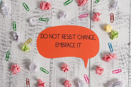 Writing note showing Do Not Resist Change Embrace It. Business concept for Be open to changes try new things Positive Blank speech bubble paper balls clips wooden vintage rustic background Stock Photo