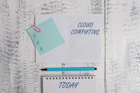 Word writing text Cloud Computing. Business photo showcasing use a network of remote servers hosted on the Internet Open squared spiral notepad clip note highlighter lying old wooden background