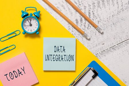 Word writing text Data Integration. Business photo showcasing combination of technical and business processes to combine Notepads clips paper sheet clipboard markers alarm clock wooden background