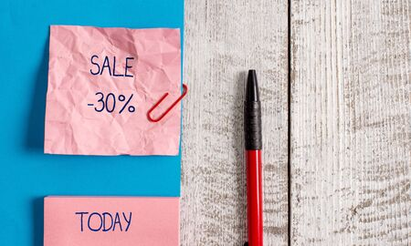 Handwriting text Sale 30 Percent. Conceptual photo A promo price of an item at 30 percent markdown Wrinkle paper and cardboard plus stationary placed above wooden background