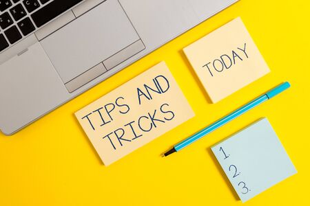 Conceptual hand writing showing Tips And Tricks. Concept meaning piece of inside facts specially in betting or investing Silver laptop square sticky notepads marker colored background