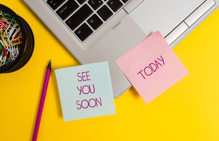 Text sign showing See You Soon. Business photo text used for saying goodbye to someone and going to meet again soon Trendy metallic laptop sticky notes clips container pencil colored background