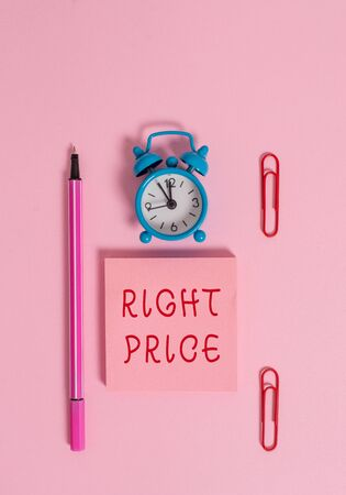 Conceptual hand writing showing Right Price. Concept meaning the amount of money that it is reasonable for the product Metal alarm clock blank notepad marker clips colored background