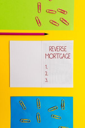 Text sign showing Reverse Mortgage. Business photo text loan for seniors age above sixties and older to be returned Blank squared notebook pencil marker paper sheets plain colored background Stok Fotoğraf