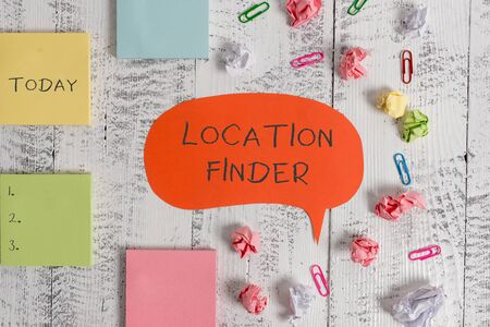 Word writing text Location Finder. Business photo showcasing A service featured to find the address of a selected place Blank speech bubble paper balls clips sticky notes old wooden background