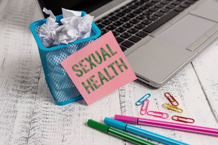 Writing note showing Sexual Health. Business concept for positive and respectful approach to sexual relationships Laptop sticky note waste basket crushed paper clips pens vintage table
