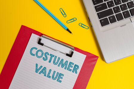 Word writing text Costumer Value. Business photo showcasing Amount of benefits which clients get from purchasing products Open laptop clipboard blank paper sheet marker clips colored background