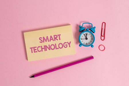 Word writing text Smart Technology. Business photo showcasing gadgets or device that has a built in computer or chip Colorful blank notepad marker retro alarm clock clip colored background