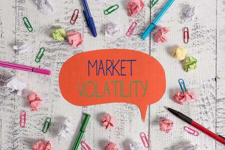 Handwriting text Market Volatility. Conceptual photo Underlying securities prices fluctuates Stability status Blank speech bubble pens clips crushed paper balls vintage retro table