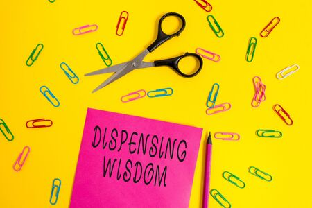Handwriting text writing Dispensing Wisdom. Conceptual photo Giving intellectual facts on variety of subjects Blank colored paper sheet scissors pencil clips light color background Reklamní fotografie
