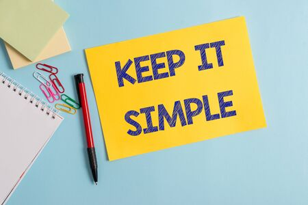 Writing note showing Keep It Simple. Business concept for to make something easy to understand and not in fancy way Plain cardboard and writing equipment placed on pastel colour backdrop Stock Photo